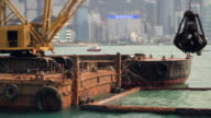 Excavator on the barge in Hong Kong at work video