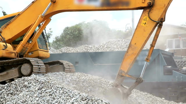 Excavator working and loading video