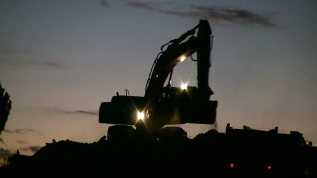 Excavator working at night video
