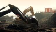 Excavators Digging Up Future Construction Site video