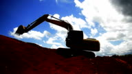 Excavators machine in construction site on sky background video