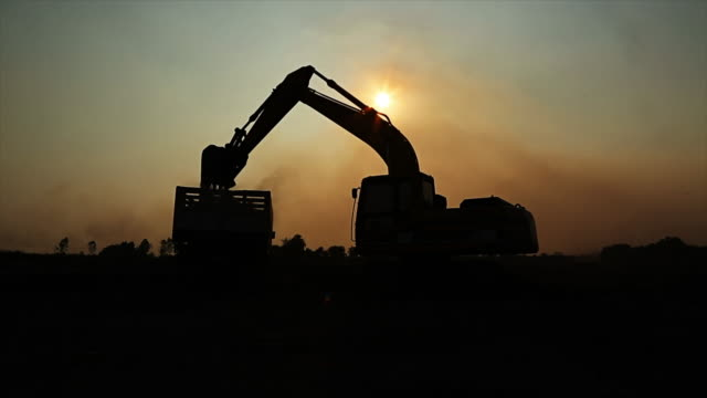 Excavators machine  working and Silhouette Backhoe video