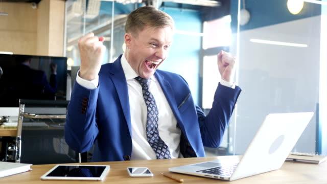 Excited businessman celebrating success video