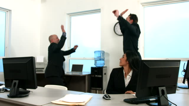 Excited businesspeople, slow motion video