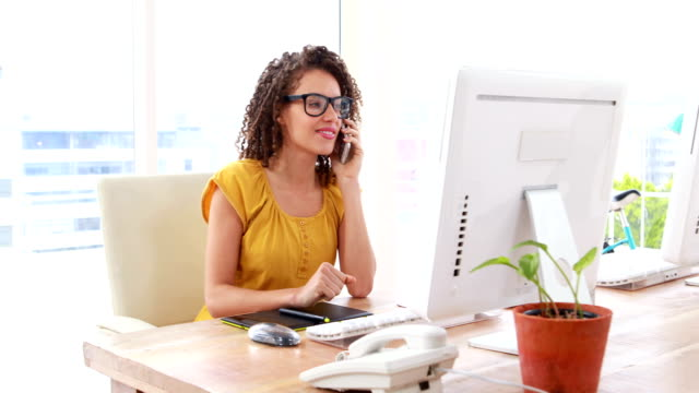 Excited businesswoman talking on the phone video