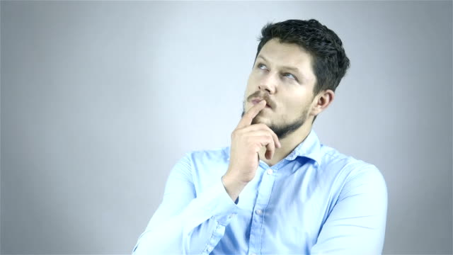 Excited caucasian businessman pointing a great idea, studio. video