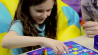 Excited child playing board game, learning process, upbringing video