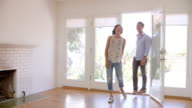 Excited Couple Explore New Home On Moving Day video