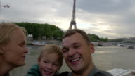 Excited family taking selfie video during traveling in Paris video