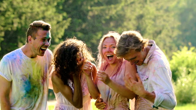 Excited group of friends soaking wet at Holi festival, summer holiday, happiness video