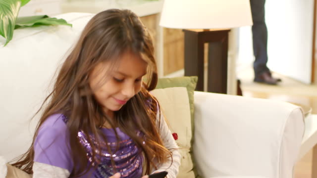 Excited little girl greets her dad at the door video