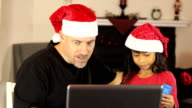 Excited Online Christmas Shoppers Using Laptop video