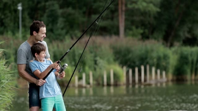 Excited son and father caught fish on bait in pond video