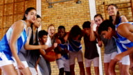 Excited Sports teacher and school students cheering in basketball court video