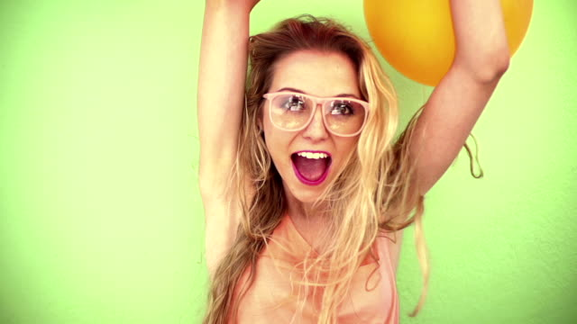 Excited surprised woman with colorful balloons video