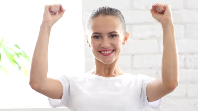 Excited Young Woman Celebrating Success, Portrait video