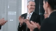 SLO MO Executive director applauding to employees success video