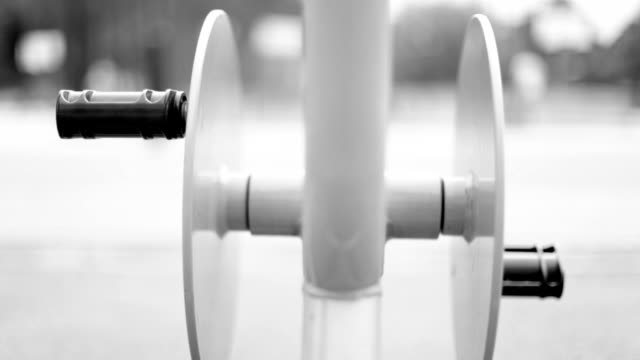 Exercise Bike, pedals, black and white video
