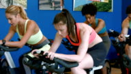 Spin class working out in the gym video