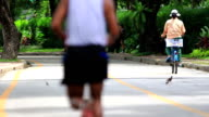 Exercise Video. Jogging Cycling City Park Southeast Asia. Slow Motion video