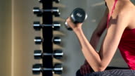 Exercise with dumbbells at the gym video