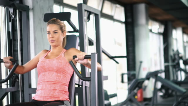 Exercising in a gym. video