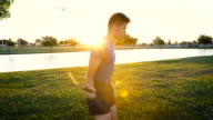 Exercising In The Park At Sunset video