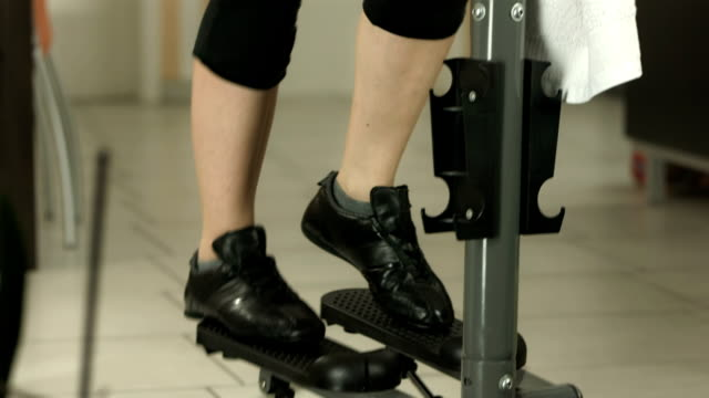HD DOLLY: Exhausted Exercise On The Stair Climbing Machine video