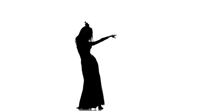 Exotic belly dancer woman starts dance on white, silhouette video