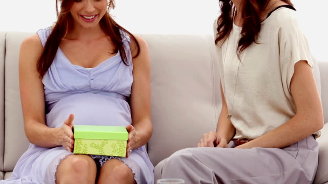 Expectant mother getting a present from friend video