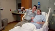 Expecting Couple Taking Selfie Together In Hospital Room video