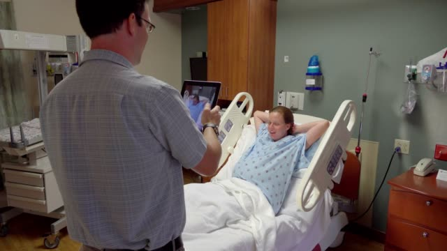 Expecting Father Taking Picture of Pregnant Wife In Hospital video