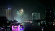 Exploding fireworks over chaophraya river in bangkok Thailand video