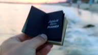 Explore Dream Discover - book with an inscription and the sunset on the beach. Travel book idea. video