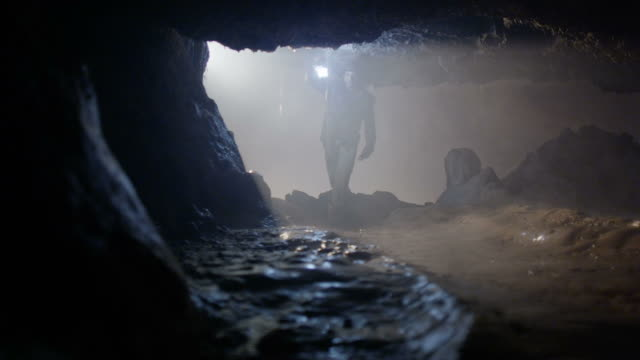 Explorer enters cave looking for treasure video