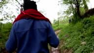 explorer hiking on a extreme terrain , climbing mountain video