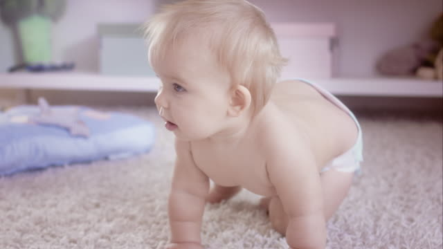 Exploring the floor- baby crawling video