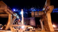 Express Way Construction Tite with Traffic on Road while Bridge Girder Erection Machine Lifting Heavy Cement Block video