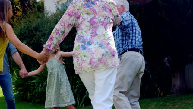 Extended family in the garden video