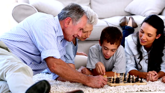 Extended family playing chess together video