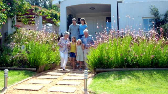 Extended family smiling in the garden video