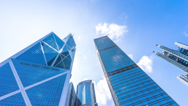 exterior of top of modern building and skyline of Hong Kong time lapse 4k video