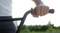CLOSE UP DOF: Extreme bmx biker holding handlebar grip in sunny evening in city video