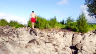 Extreme Cliff Jumping Backflip. Summer Extreme Sports Shot from Above Aerial View. video