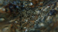 Extreme close up granite stone with water mirror video