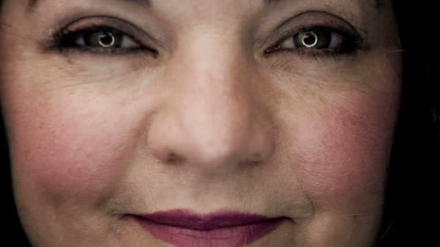 Extreme close up: Middle-aged Hispanic woman smiles video