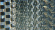 Extreme close up of a bike reflector day video