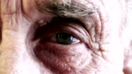 extreme close up of a blue eye of a senior man video