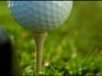 NTSC - Extreme close up of golf ball tee off video