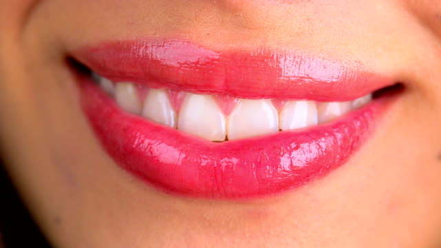 Extreme close up of lips blowing a kiss and smiling video